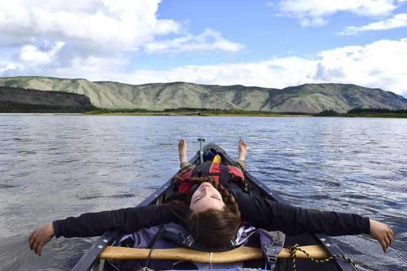 floating on the Yukon River in a canoe