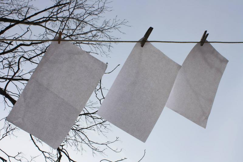Paper hanging on the clothes line