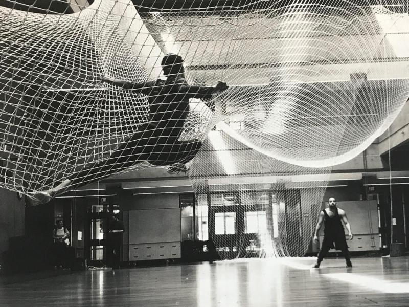 Dancers in hanging nets