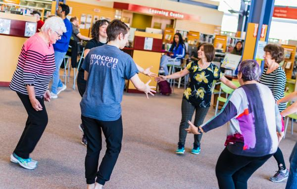 Dancing in the library with a community group