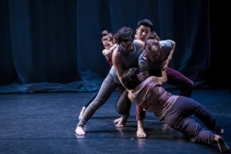 Five dancers in a group configuration