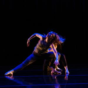 Dancer in blue light leaning back with passion